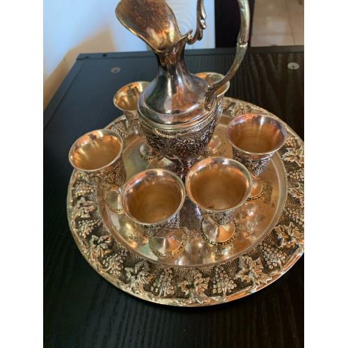 Bronze mug antique with 6 small glasses